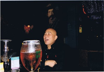 Chan Hoi & David Hide enjoying a small beer in Canton.   Photo from the Hide family collection ©