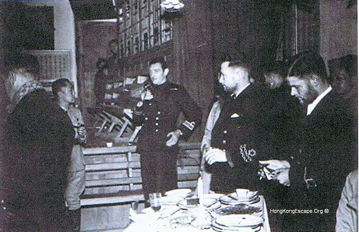 Dr Robert Lim with Lt-Cdr Gandy RN & officers at Kweiyong 24th Jan 1942.  Run the curser over to identify individuals.