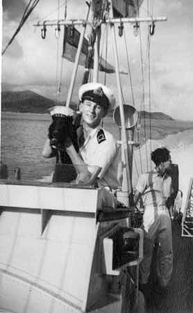 Sub-Lt David Legge with the ships dog Brucey ;      Photo from Lt C J Collingwood's collection ©