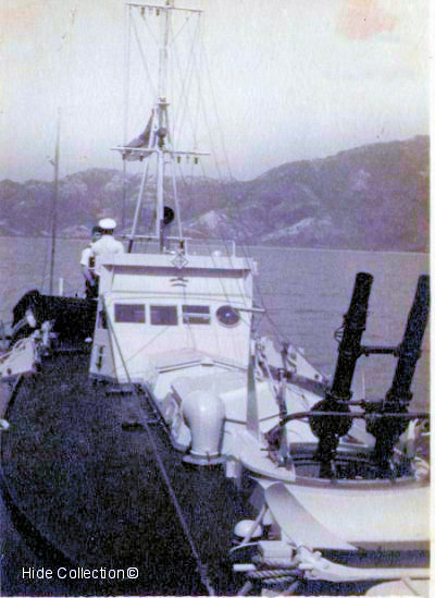 John (Jix) Prest on board MTB 07 alongside (HMS Robin) in Mirs Bay.        Photo from Buddy Hide's collection ©