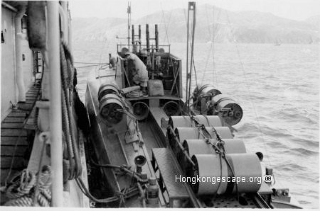 MTB 27 alongside HMS Robin in Mirs Bay loaded with depth charges.      Photo from the Hide collection ©