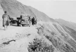 The Red Cross trucks high on the Burma Road above the Salween river Feb 1942.      Photo from the Ashby family collection ©